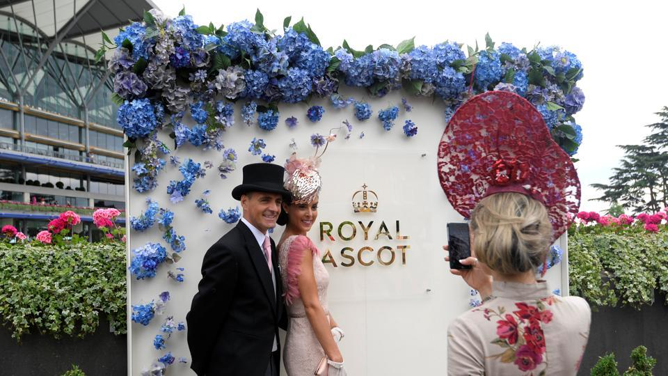 Racegoers take photo during Ladies Day at Ascot . (Toby Melville / Reuters)