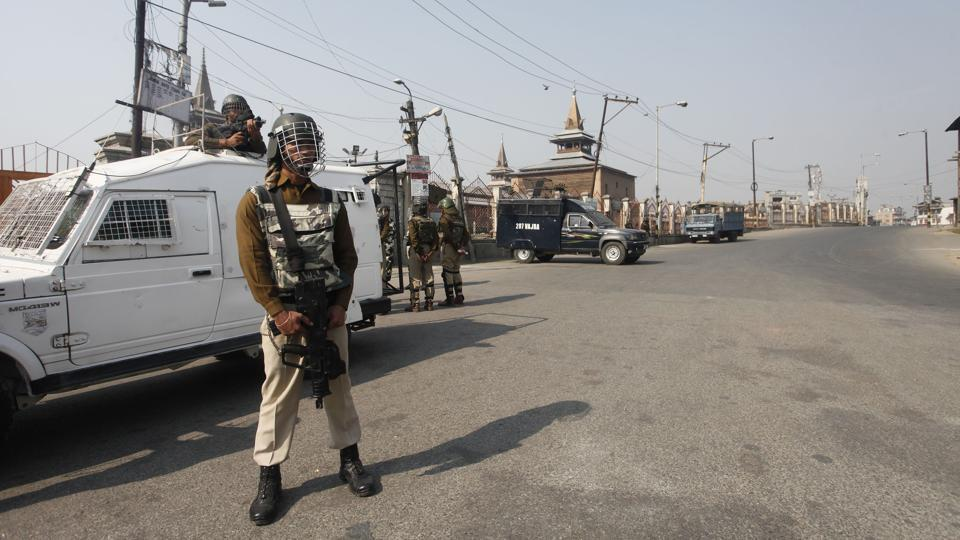 A paramilitary soldier patrols in front of the Jamia Mosque in Srinagar.