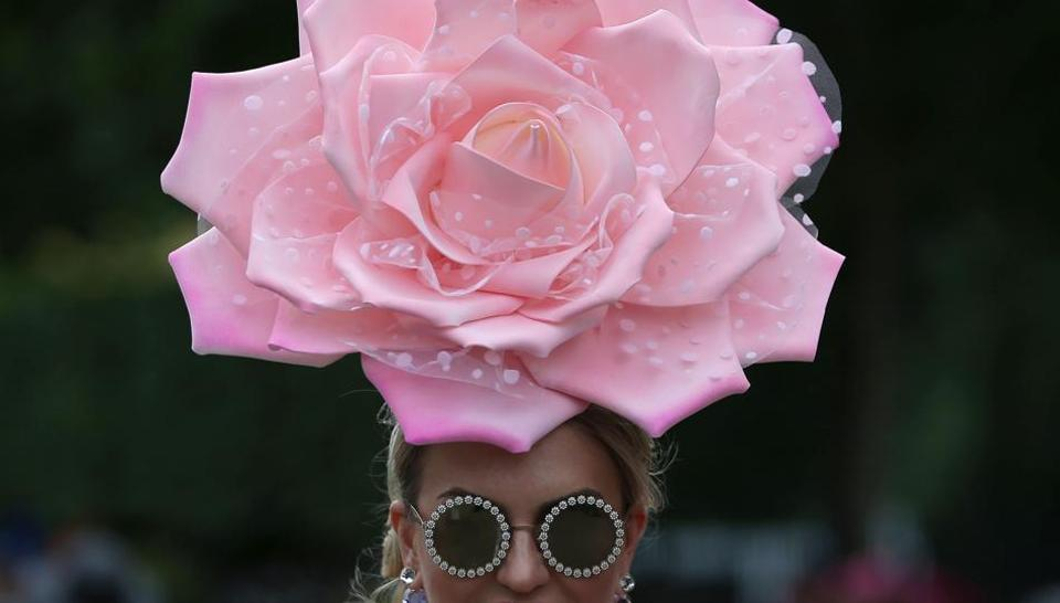 Ladies Day at Royal Ascot — a prime event on the fashion calendar when racegoers meet royalty at the famous track in one of the wealthiest parts of the UK. The five-day meeting is one of the highlights of the horse racing calendar.  (Daniel LEAL-OLIVAS / AFP)