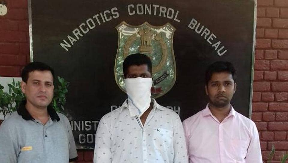 The accused, Romeo William Sampson of Mumbai, in custody of Narcotics Control Bureau (NCB) officials in Chandigarh on Saturday.