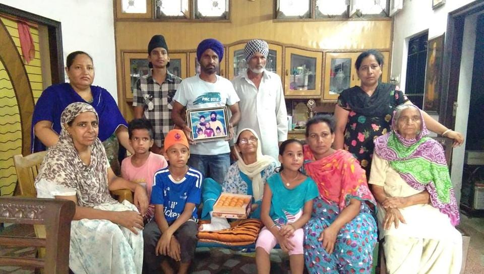 Family members of Palbinder Kaur Shergill celebrating her appointment as the first turbaned (Amritdhari) Sikh woman judge of the Supreme Court of British Columbia in New Westminster at their house in Jagatpur village of SBSNagar district.
