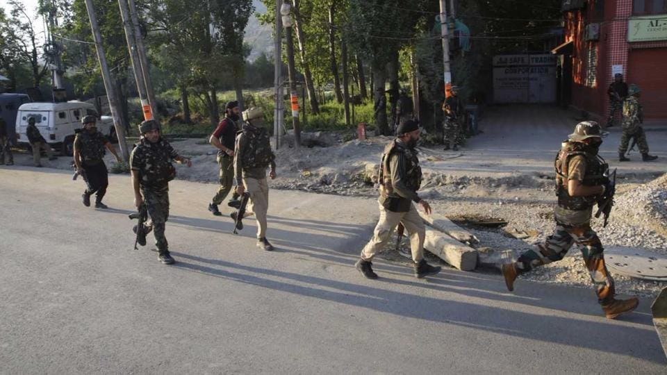 Security forces conduct cordon and search operations in Srinagar after militants ambushed a vehicle, killing one and injuring another.