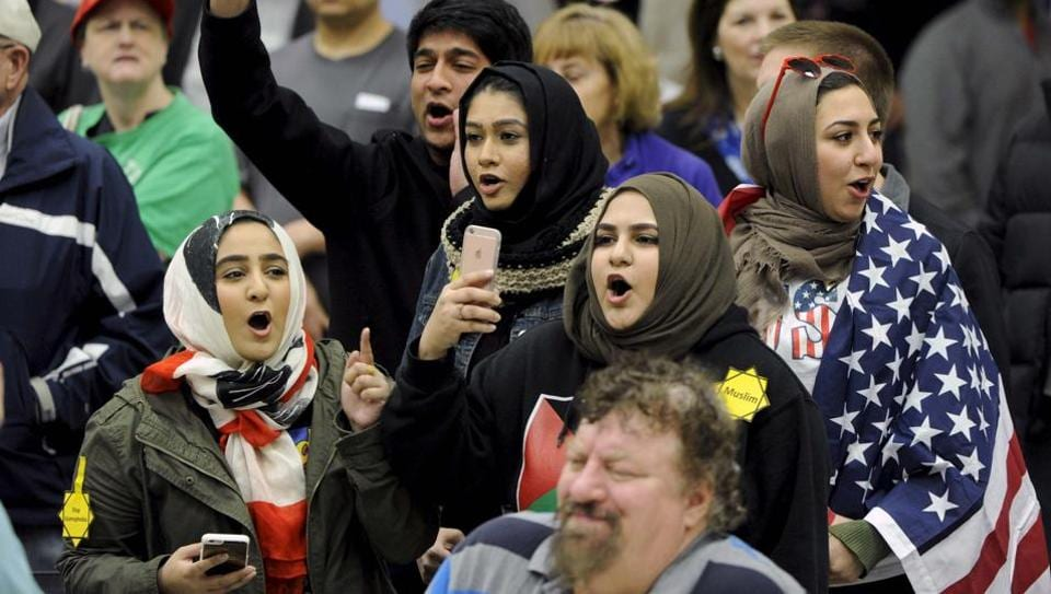 FILE PHOTO - Young Muslims protest against U.S. Republican presidential candidate Donald Trump before being escorted out during a campaign rally in the Kansas Republican Caucus at the Century II Convention and Entertainment Center in Wichita, Kansas March 5, 2016.