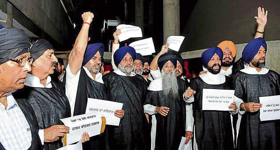 BLACK ROBE PROTEST: (From left) Three non-Sikh MLAs — BJP's Som Parkash and Arun Narang, and SAD's NK Sharma — wear 'patka' and turban to express solidarity in protest with SAD chief Sukhbir Badal and others, at the Vidhan Sabha complex in Chandigarh on Friday.