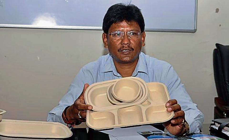 Additional commissioner, Garhwal, Harak Singh Rawat displays  biodegradable tableware in Dehradun on Saturday.