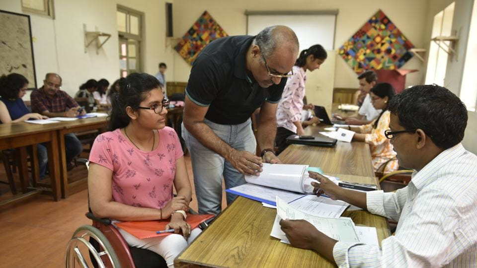 Students take admissions at Delhi University on Saturday.
