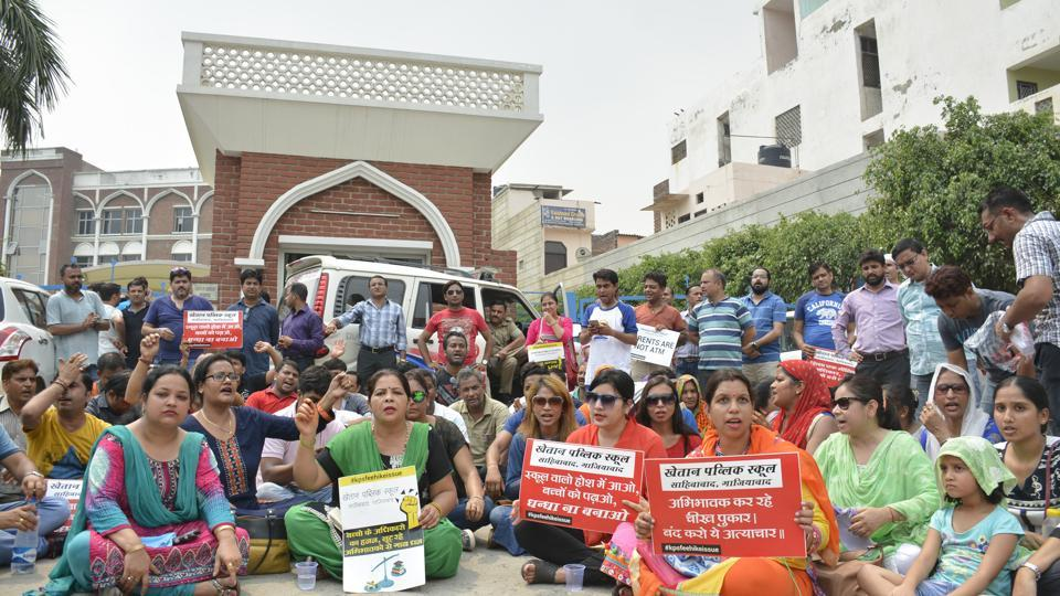Parents of expelled students stage a protest outside Khaitan Public School in Ghaziabad on Saturday.