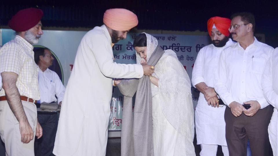 Punjab local bodies minister Navjot SinghSidhu honouring  Dr Jaspreet Kaur, granddaughter-in-law of Master Tara Singh, at  Amritsar on Saturday.
