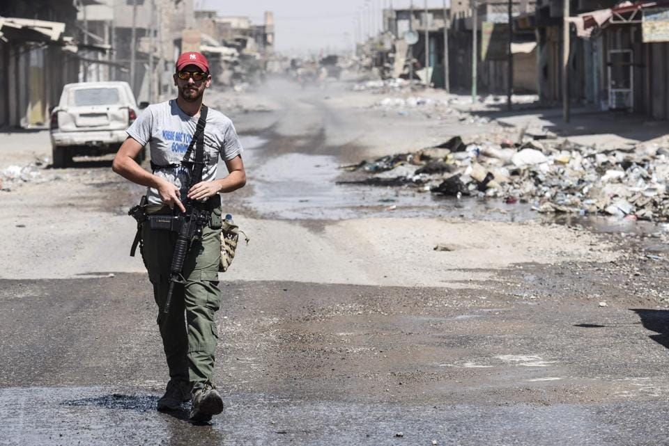 An Iraqi forces member patrols Mosul's industrial zone.