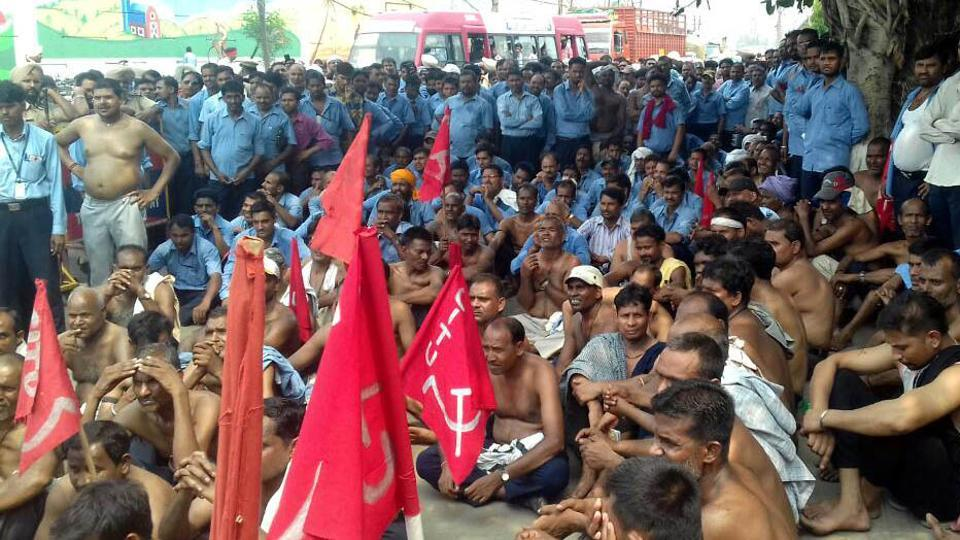 Laid off employees of HeroCycles intensified their protest by removing their clothes in Ludhiana on Saturday.