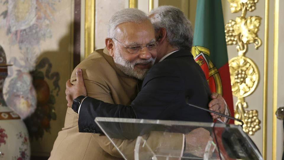 Prime Ministers Narendra Modi (left) with Antonio Costa embrace after a joint statement at the Necessidades Palace, the Portuguese foreign ministry in Lisbon, on June 24, 2017.