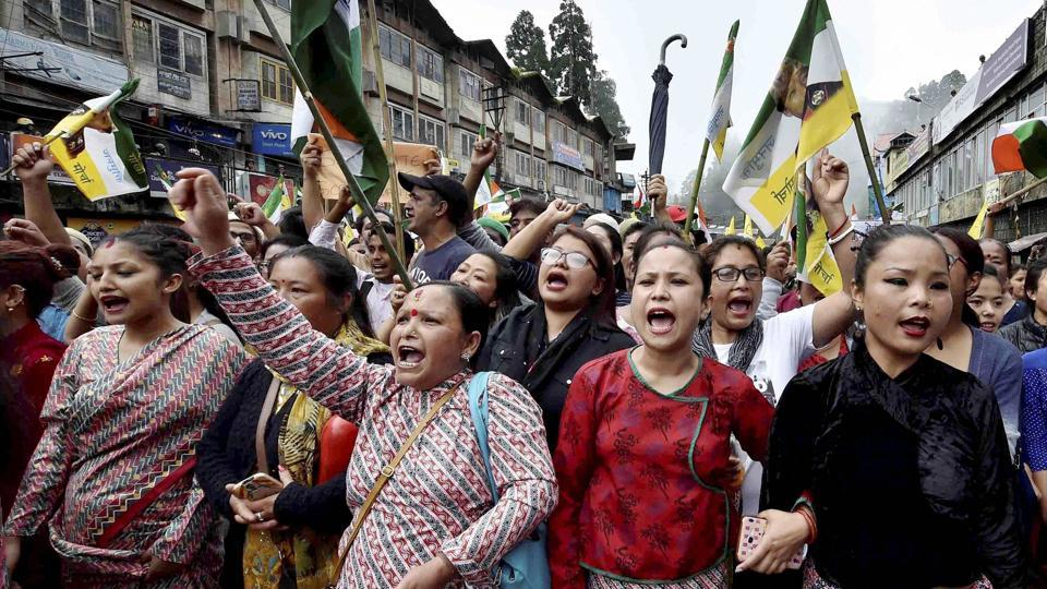 People raise slogans as they participate in a mass rally to demand for separate state of 'Gorkhaland' in Darjeeling on Saturday.