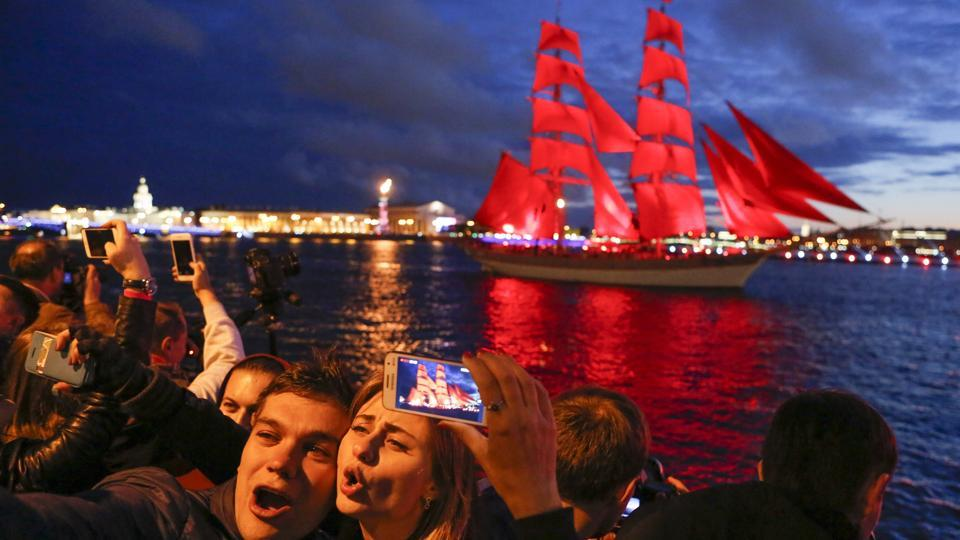 In late June, comes a grandiose holiday for all graduates - the Scarlet Sails, when more than 1.5 million people, the residents and the guests come to the Palace Square and to the banks of the Neva River to watch the performance. (Elena Ignatyeva / AP)