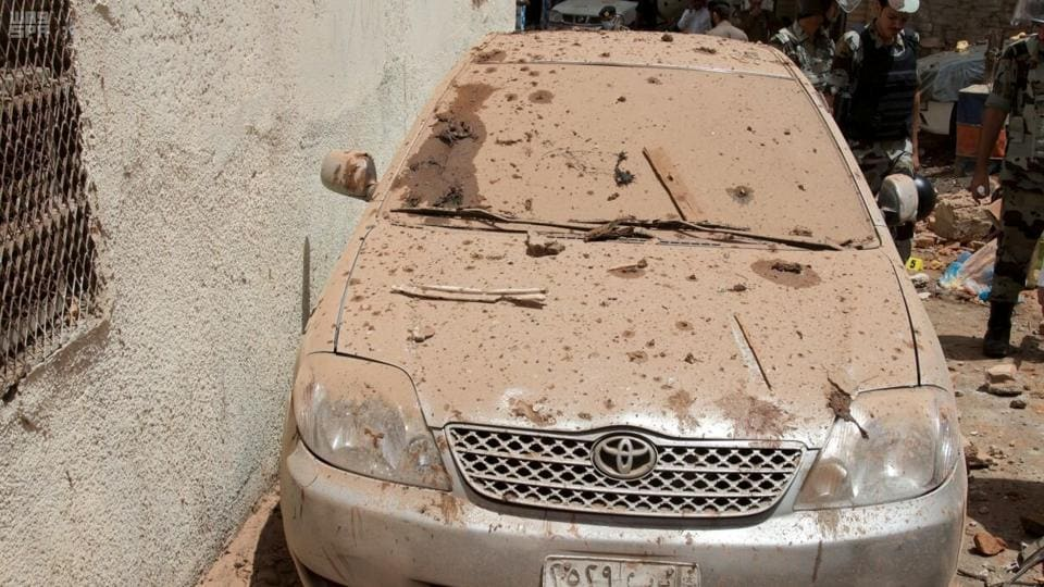 A damaged car is seen after a suicide bomber blew himself up in Mecca, Saudi Arabia June 23, 2017. Picture taken June 23, 2017.