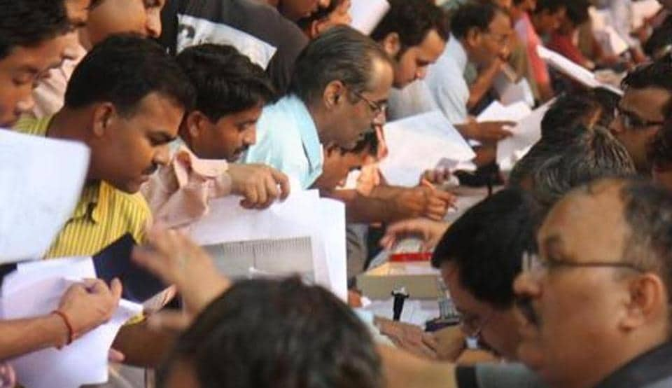 People submitting their income tax return form.