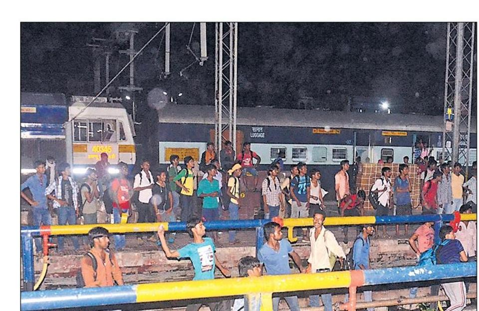 Examinees pelting stones at trains at the Muzaffarpur railway station of north Bihar, late evening on Saturday.