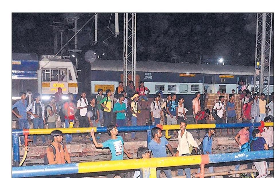 Examinees pelting stones at trains at the Muzaffarpur railway station of north Bihar, late evening on Saturday.