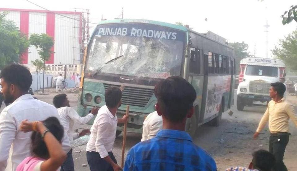 The protest near Khambra in the evening turned violent when a Punjab Roadways bus was pelted with stones by Christian community members; passengers and staff had managed to get off it.