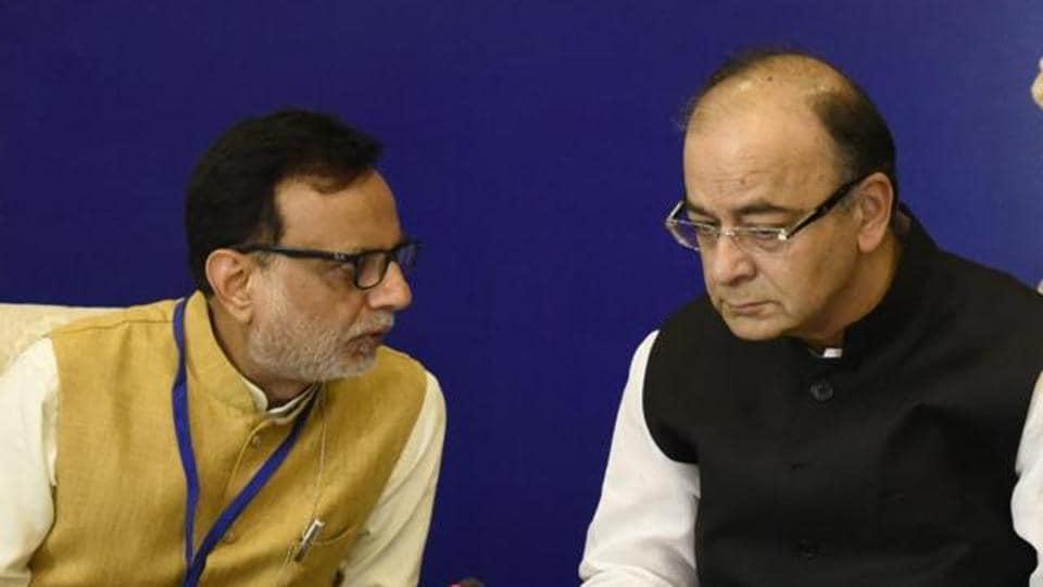 Finance minister Arun Jaitley and revenue secretary Hasmukh Adhia at a press conference.