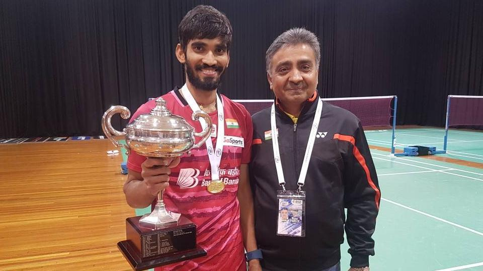 Kidambi Srikanth poses with the Indian team manager after his Australian Open Superseries win in Sydney on Sunday.