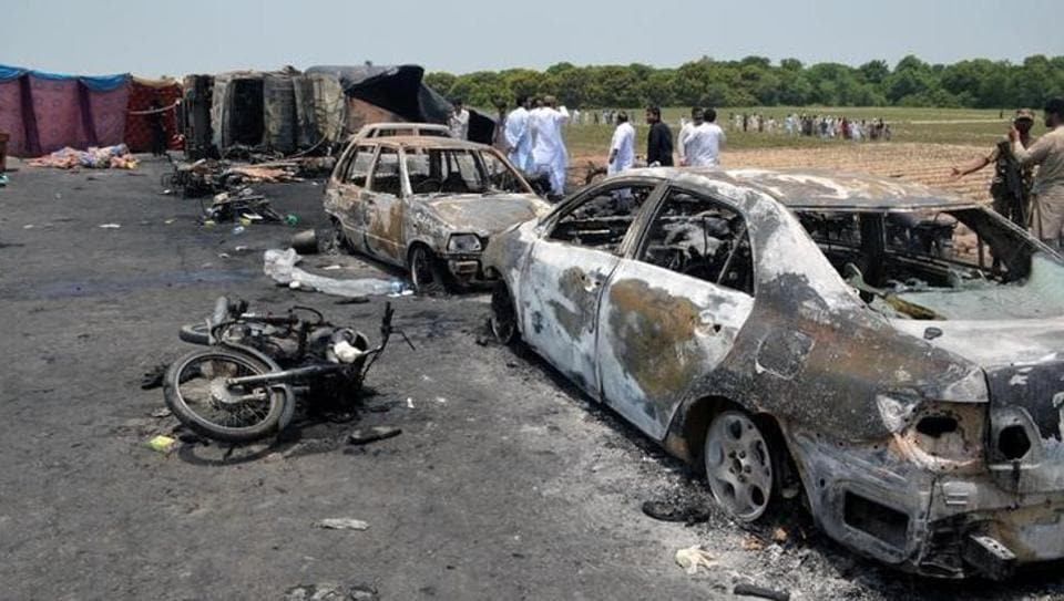 Burnt cars and motorcycles at the scene of an oil tanker explosion in Bahawalpur in Pakistan. (REUTERS)