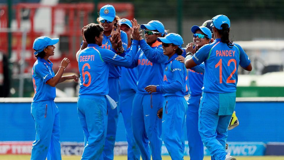 The Indian cricket team celebrates after defeating hosts England in the ICCWomen's World Cup at Derby on Saturday.