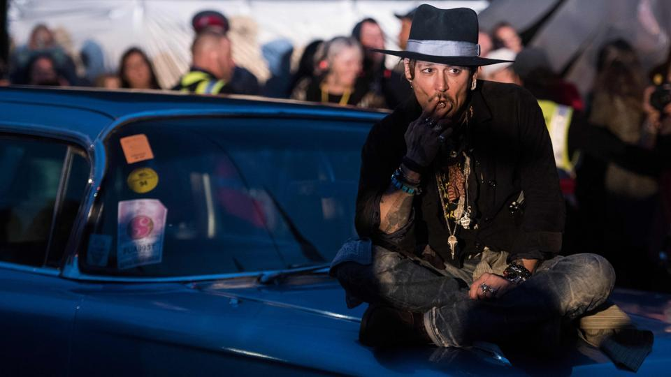 Actor Johnny Depp arrives to introduce his film, The Libertine, to the audience at 'Cineramageddon', the outdoor cinema venue, at the Glastonbury Festival of Music and Performing Arts on Worthy Farm near the village of Pilton in Somerset, South West England, on June 22, 2017.  (Oli Scarff/AFP)