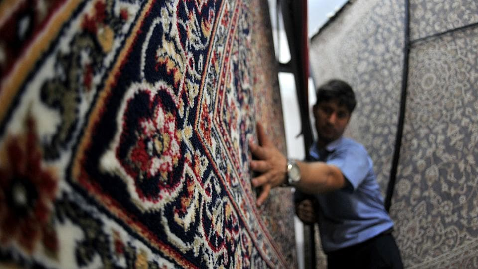 An employee working at a carpet weaving factory in Bari Brahmana industrial area on Sunday. (Nitin Kanotra/HT Photo)