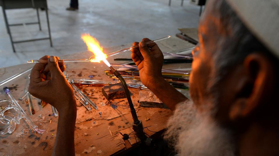 An artisan attends a government-run training workshop to learn new techniques in glass art at Firozabad.