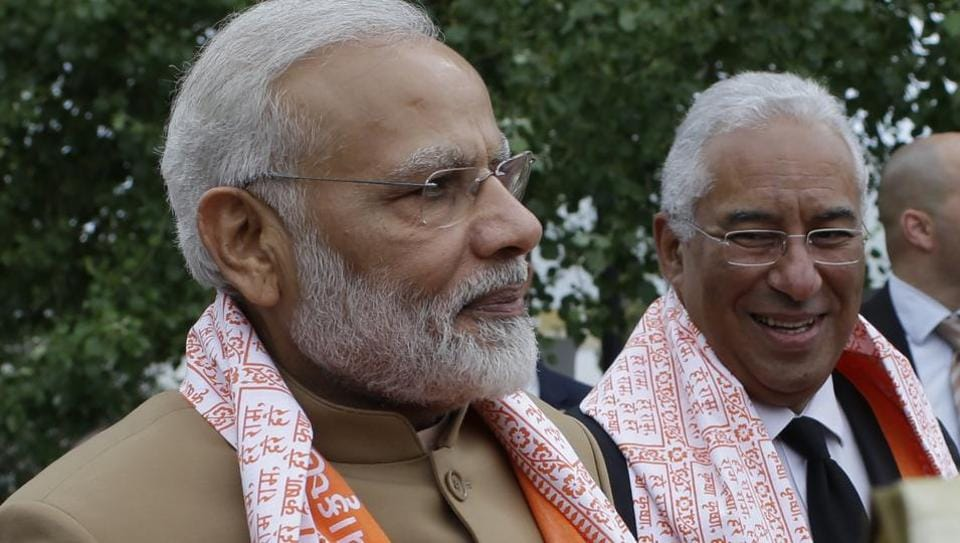 Prime Minister Narendra Modi and Portuguese Prime Minister Antonio Costa, right, stand together after being given ceremonial shawls during a visit to the Radha Krishna Temple in Lisbon. Modi visited Portugal in the first leg of his three-nation tour -- before heading for the US.