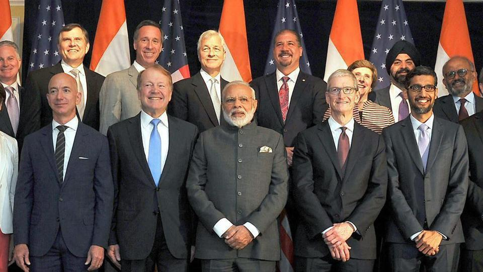 Prime Minister Narendra Modi poses for a group photograph with US business leaders at a meeting in Washington DC on Sunday.