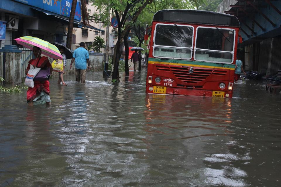 A flooded street in Thane after the rains on Sunday.