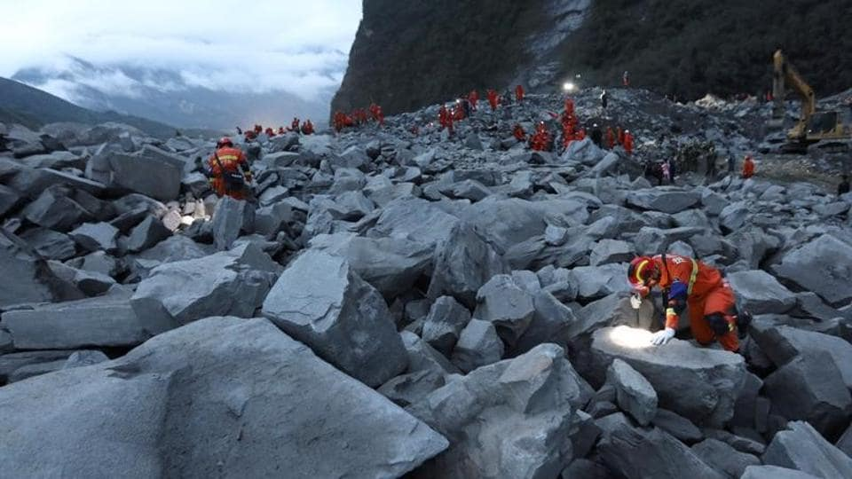 Rescue workers search for survivors at the site of a landslide in Xinmo village of Mao county in Sichuan province. REUTERS