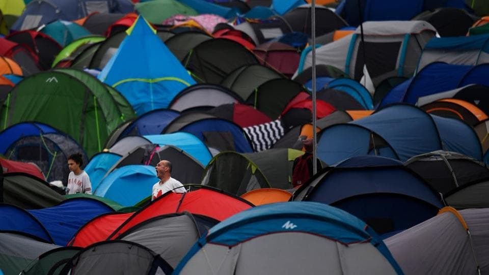 Revellers emerge from their tents at Worthy Farm in Somerset during the Glastonbury Festival, in Britain on June 22, 2017.  (Dylan Martinez/REUTERS)