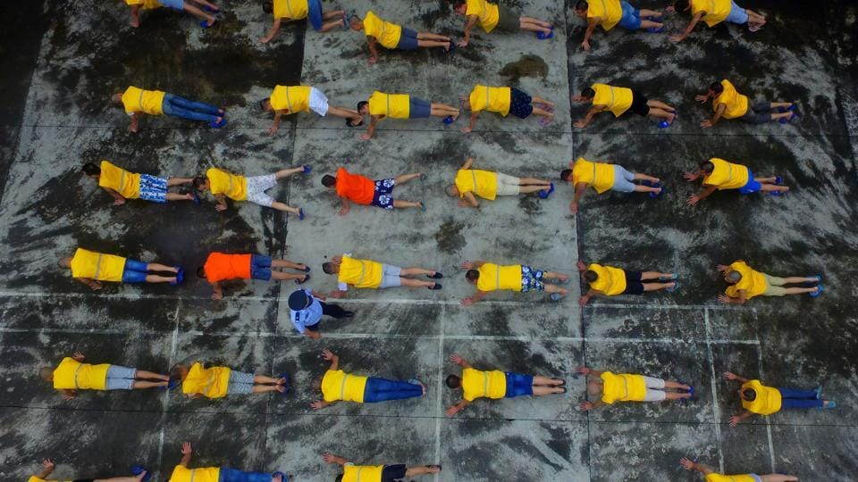 This photo taken on June 22, 2017 shows inmates exercising at a forced drug rehabilitation centre in Rongan, in China's southern Guangxi region. China marks the United Nations International Day against Drug Abuse and Illicit Trafficking on June 26.  (AFP)