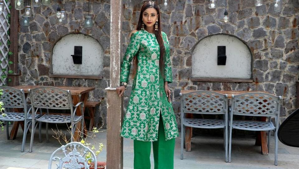 Model Devika Das pairs her emerald green Banarasi kurta with silk pants (Raw Mango) and temple inspired dangler earrings.  (HT Photo/ Shara Ashraf; Styling: Shara Ashraf )