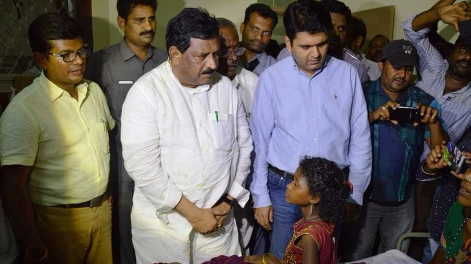 Deputy chief minister N Chinna Rajappa meets with the tribals at Rampachodavaram hospital on Monday.