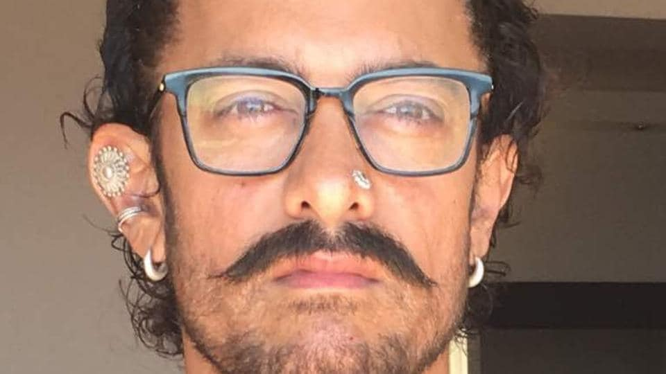 """For his new film, Aamir Khan has gone in for a """"completely different look"""" thanks to a nose piercing and two piercings on his right ear."""