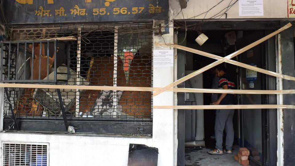 Two fire tenders were pressed in service to douse the flames at HDFC Bank branch in SAS Nagar on Monday.