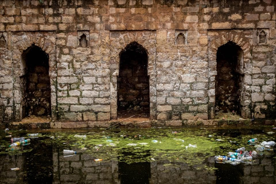 Like most baolis of Delhi, the water at 'Rajon ki Baoli' is covered with moss and garbage.