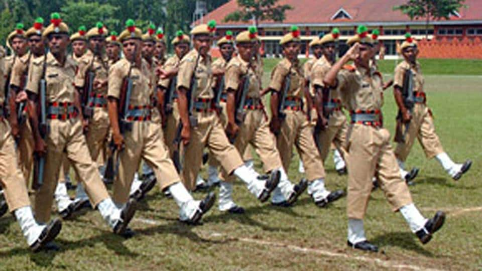 Assam police march during a parade in Guwahati.