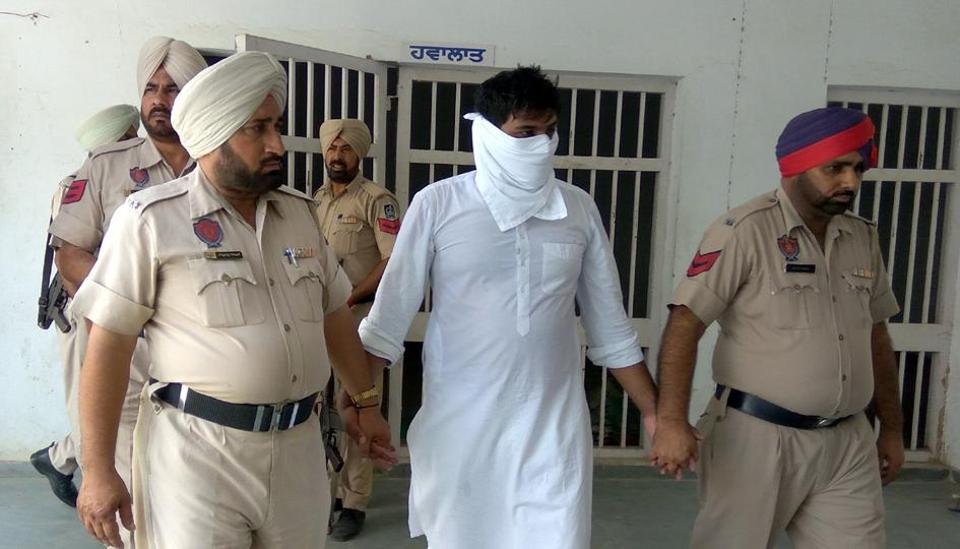 Cops taking accused Amrinder Singh Raju in a court in Talwandi Sabo on Sunday.
