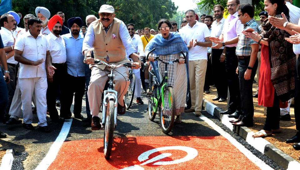 Punjab governor VP Singh Badnore and Chandigarh MP Kirron Kher during the inauguration of cycle track in Sector 8, Chandigarh, on Sunday as other senior officers of the UT administration look on.