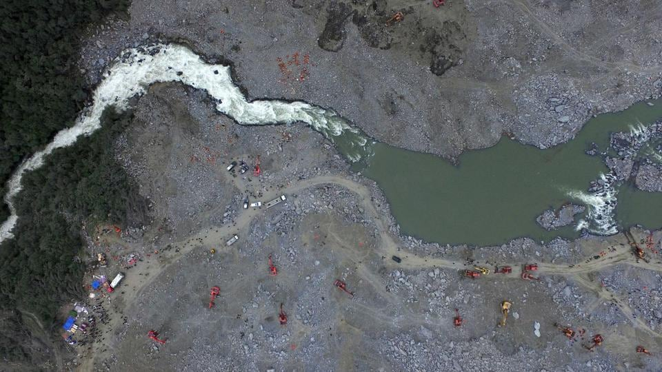 An aerial view of the landslide site. Officials have pulled  bodies from the avalanche of rocks that crashed into 62 homes in Xinmo which was a once picturesque mountain village nestled by a river in Sichuan province. (AFP)
