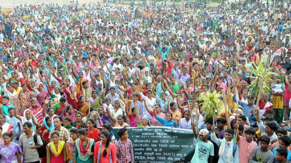 Tribals proceeding in a rally organised by Birsa Munda Ulgulan Manch in protest of state government's proposed amendments in CNT and SPT Acts