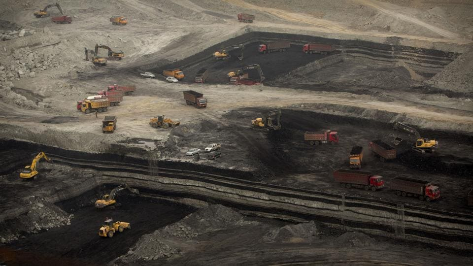 Vehicles work at an open-pit coal mine near Ordos in northern China's Inner Mongolia Autonomous Region.
