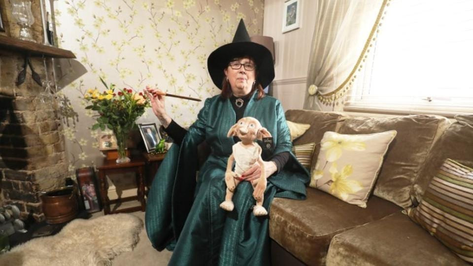 Harry Potter fan Maria York poses in her Professor McGonagall costume at her home in Grays, Britain. (Neil Hall/Reuters)