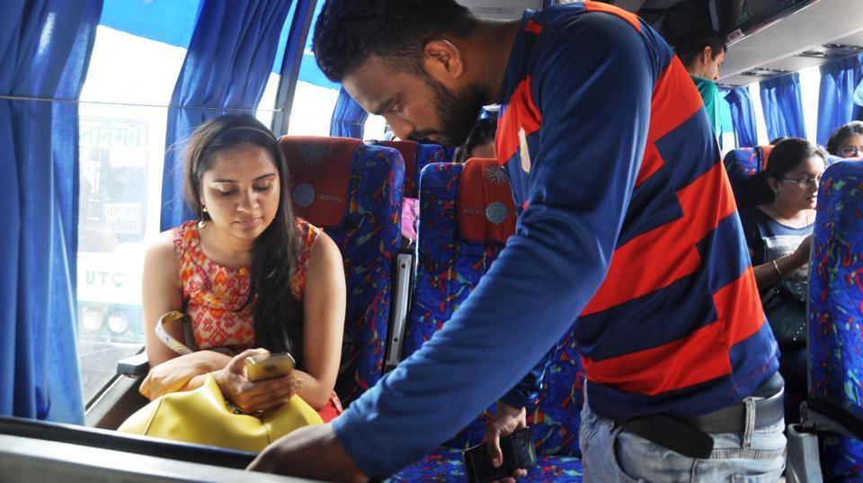 A passenger looks for Wi-Fi details in a high-end bus in Dehradun.