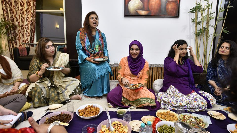 """These are holy objects of secular culture. They are not the stereotypical decorations for a prayer room. Yet on Wednesday, they were precisely what surrounded Nazia Erum as she performed namaz during an """"interfaith Iftar"""" party at her home in Noida. It was the last such event in a booming season of them. Earlier this Ramazan, Erum, a 30-year-old writer and clothing designer, had posted on Facebook asking if any of her friends had never attended an Iftar. She heard back from over ten times the number of people she expected. (Arun Sharma/HT PHOTO)"""