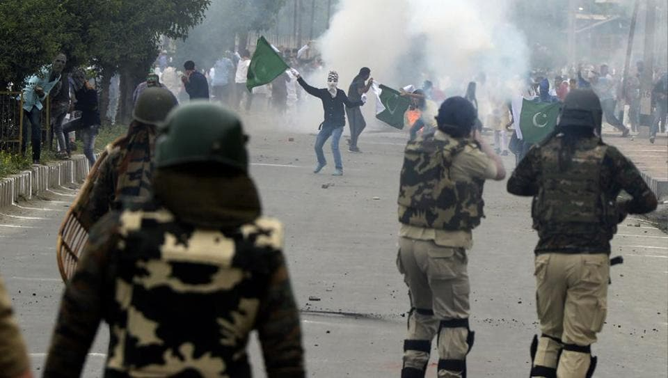 Kashmiri protestors clash with security forces after Eid prayers in Srinagar on Monday.